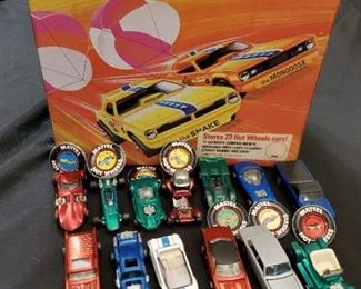 Original 1960s Hot Wheels Red Line vehicles -- dozens in the collection -- with pristine collector's case and badges