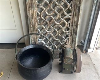 Heavy cauldron and decorative wood screens and unusual old motor