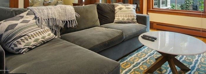 Sectional sofa with chaise lounge, marble top table & rug