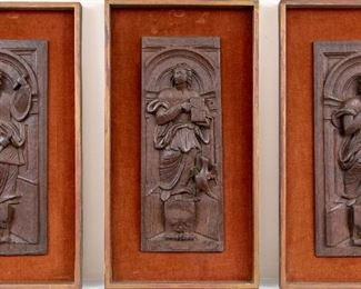 A Group Of Three Carved Wood Relief Plaques