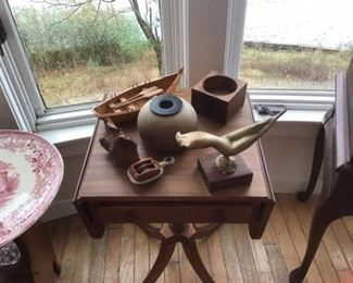 Various wooden items, row boat, flower holder, bronze statue Mesgeve