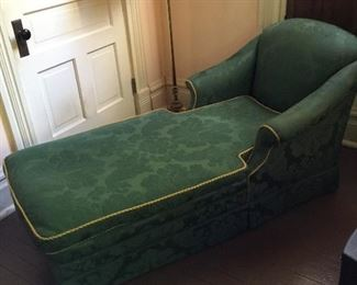 Antique chaise lounge with damask upholstery, down cushion and gold ribbing