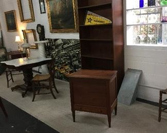 Good size wood bookcase, empire marble top square center table, pair antique cane seat chairs