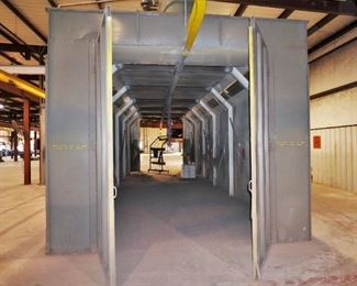 Binks spray booth with an I-beam conveyor system and fire suppression system - includes spare filters and heat lamp – approx. 50' long