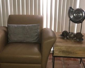 Modern table and leather armchair