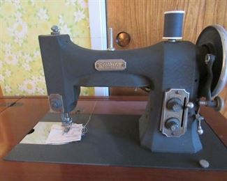 White sewing machine with cabinet