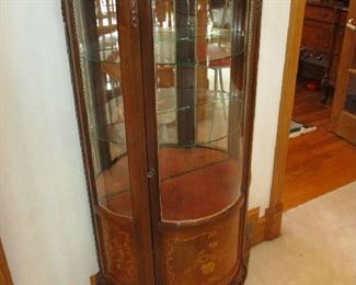 Curved front curio cabinet, ornate and in great condition