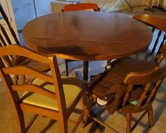 kitchen table with misc chairs