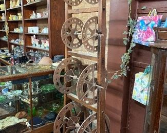Antique  rope reel rack hardware display dispenser which is original to this 1880's building when it once served as a hardware store and mercantile.