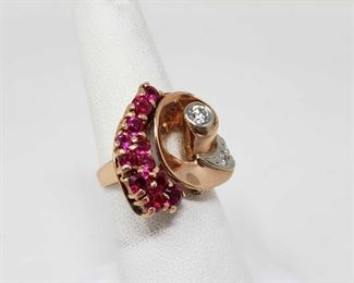 103: 14k Gold Diamond and Ruby Ring,7.7 This Beautiful 14k Gold Diamond ruby ring weighs approximately 7.7g and the size is approximately 7. Metal Type: Yellow Gold Ring Size: 7 Gemstones: Ruby