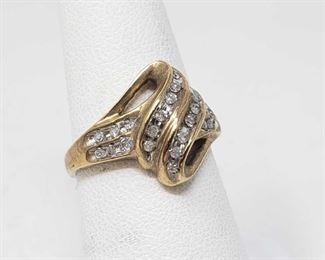 153: 10k Gold Diamond Channel Setting Ring, 3.4 This Beautiful 10k Gold Diamond Channel Setting Ring is approximately a Size 7 and weighs approximately 3.4g Metal Type: Gold Ring Size: 7 Gemstones: Diamond