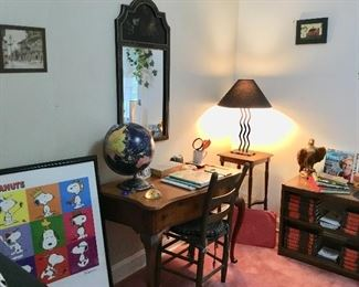 Office with desk& chair, vintage framed snoopy poster, vintage lamp, eagle statue, tole painted mirror, lamp table