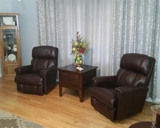 These two leather leather rocker recliners match the sofa.