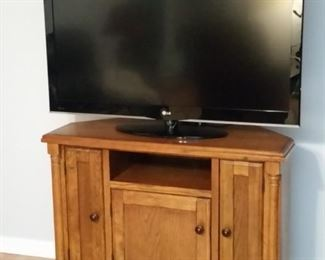 LG LCD 47 inch TV .  Oak cabinet has angled back corners so it can also be used as a corner cabinet