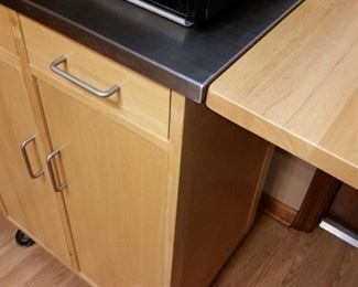 A closer look at the microwave cart/cabinet