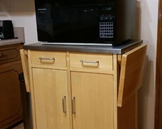 Microwave cart/cabinet is made of maple and has a stainless steel top