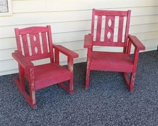 Two small red rockers