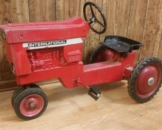 Vintage die-cast pedal International tractor