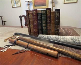 Two English canes, decorative faux ivory tusk, new High spirits flute, Collectors Edition gilt edged leather bound Hundred Greatest book series