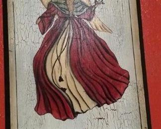 Christmas angel on wood.