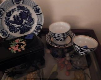 Old china, display table and stone fruit.