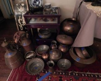 a collection of copper pots and more