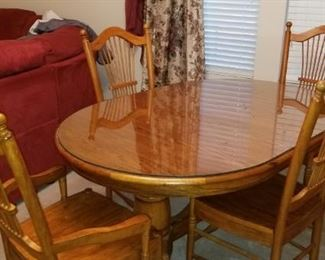 Beautiful Table with 2 leaves and 6 chairs plus a glass top protector