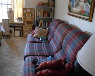 recliner couch, picture frames, books