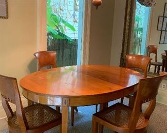 Beautiful Biedermeier Dining Table and chairs. We just discovered a large dining leaf that will expand  the table to seat 10 comfortably. Chairs priced separately