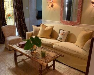 Villa Vici slipcovered down sofa with custom pillows. Great looking bamboo coffee table. PLEASE NOTE the mirror above sofa is not being sold.!! Owner decided to keep.