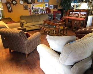 We have more contemporary fabric sofa's, love seats, and casual chairs!