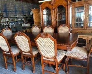 Incredible Dining room set.  Table with 8 chairs and 2 leaves.  Matching China Cabinet.  Perfect for the holidays!