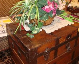 Large antique wood travel trunk.