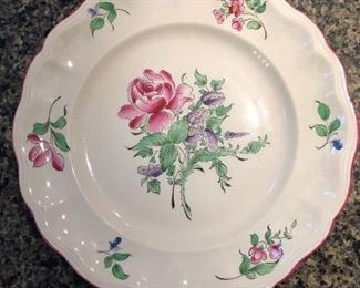 One of several hand painted French plates