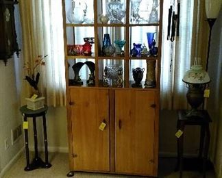 Great display cabinet with lead crystal vases, pitchers, Roseville and Weller pottery, brass, cobalt glass and Bohemian cut to clear glass, Bradley Hubbard Lamp