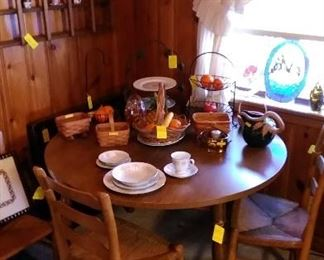Round table with 2 leaves, ladder back rush bottom chairs, Longaberger baskets, leaded glass sun catchers