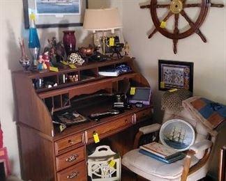Great roll top desk, ship's helm, Chantz art work, motion lamp, brass lamp, etc.