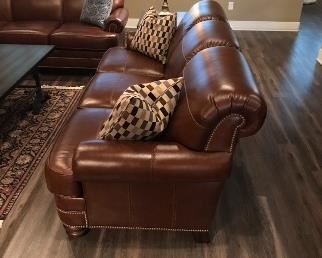 Beautiful brown leather 3 cushion couch