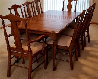 Beautiful dining table, two leaves & eight sturdy chairs including two host chairs