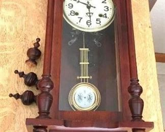 "R A Prince 31 Day Wall Clock	 Dark Wood, Finials are loose but with the clock; 11""w x 6-1/2""d x 32""h"