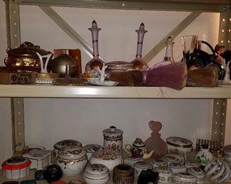 Perfume bottles, small porcelain boxes, Half-doll brushes (lying on top shelf...)
