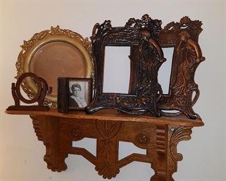 Shelf displaying frames