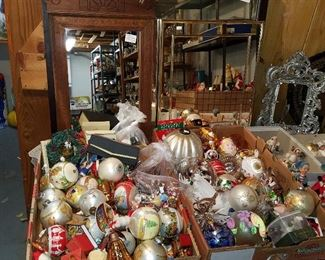 Christmas ornaments in front of framed mirrors