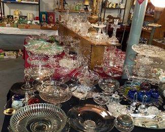 Tables of glassware