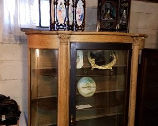 Curved china cabinet (right glass panel missing)  Partially stripped of original finish showing oak construction