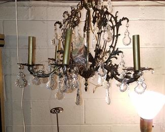 Chandelier with prisms (additional prisms in plastic bag in center.  Metal 'thingy' below chandelier to left is a store display for hats