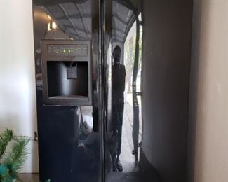 LG fridge with water and ice dispenser.