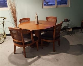 Circa 1950s Henredon walnut dining table and 4 cane back chairs.