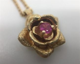 14k Flower Pendant with Ruby https://ctbids.com/#!/description/share/274651
