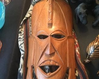 Hand carved Tribal masks and loomed fabric